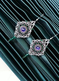 Check out this item in my Etsy shop https://www.etsy.com/listing/594666344/purple-swarovski-earringsopenwork