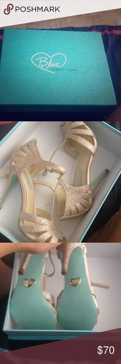 Betsey Johnson They are gold and glitter. I only worn them for 3 hours for a weeding I was in they are like brand new.they are more like a champagne color make a offer don't be afraid Betsey Johnson Shoes Heels