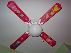 I just made this fan for Lucy.  remove fan blades and spray paint, sparkle glitter while still wet, decoupage cutouts from her fave book pinkalicious.  total cost 4.98