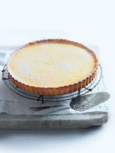 for classic lemon tart is a sweet and zesty dessert ideal for entertaining.recipe for classic lemon tart is a sweet and zesty dessert ideal for entertaining. Lemon Recipes, Tart Recipes, Sweet Recipes, Baking Recipes, Dessert Recipes, Slow Cooker Desserts, Sweet Pie, Sweet Tarts, Sweet Sweet