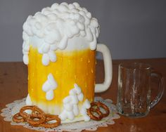 Have a Beer! - Round cakes covered in BC w/fondant handle.