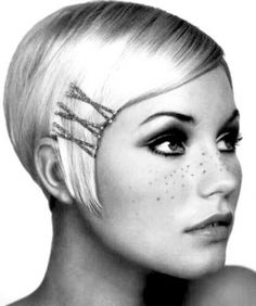 Try pinning down your fringe with bobby pins to give your short pixie that classy, cute retro look.