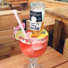 happy friday! || this epic looking drink is the Strawberry Coronarita (tequila, strawberry puree and Corona) from #CrazyWings || as you drink room is made for the Corona to come on down || lime and mango flavours are also available || patio weather come back!