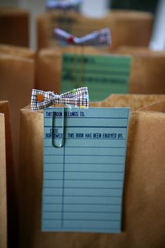 Bookswap Favor Idea- Clip library cards to paper bags with homemade bookmarks. They will have a bag to bring books home in AND a way to keep their spot