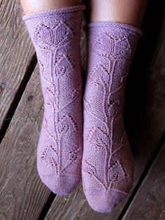 This is a toe-up sock pattern that uses many large charts to get the climbing vine that blooms at the top of the sock near the cuff. The pictured socks have a relaxed circumference of 7 inches and a stretched circumference of 10 inches.