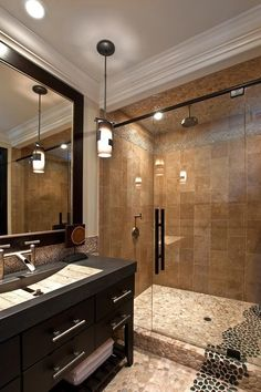 Large tan black pebble tile shower and bathroom flooring and shower ceiling