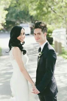 Brendan Urie and his beautiful wife haha he's so awkward
