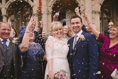 Confetti throw outside Clevedon Hall wedding venue, photography by Becky Male