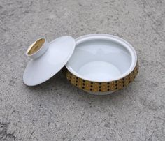 Porcelain vintage bowl in white with Art Deco inspired Repetitive pattern in golden and Black. Very suitable and decorative to use on the table as a sugar or smaller biscuit bowl. Marked bottom Royal Dux. Made in: Czechoslovakia Material: White glossy porcelain coated golden and black. Condition Very good, with a smaller vintage mark ( see picture)  Size: Diameter 14 cm (5,5inch) Height 11cm (4,3 inch)  Delivery worldwide. IMPORTANT : If you are from outside European union please contact me…