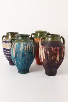 A traditional olive jar from Turkey is handpainted with vivid splatters and translucent blears by LA artist Caitlin Dinkins. www.anthropologie.com