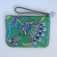 "Vera Bradley Shimmer Wristlet Emerald Paisley Vera Bradley Shimmer Wristlet in Emerald Paisley.  New without tags!  Adorned with sequins and cute silver trim.  This measures 7 1/2"" x 5 1/2"" with a 6"" strap. Inside there are 3 cc slots and another large slot on the other side.  Comes from a smoke free and pet free home.  Please no trades or Paypal.  :) Vera Bradley Bags Clutches & Wristlets"