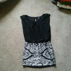1 piece dress SZ:M - pure black on the top that is sleeveless.  Bottom of the dress is classy sequenced, and it's all connected Love Reign Dresses
