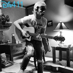 Ross Lynch playing the guitar