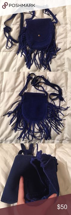 Blue Suede Crossbody Bag with Fringe Dark blue suede crossbody bag with fringe. Gently used. A perfect statement bag for festivals! American Vintage Bags Crossbody Bags