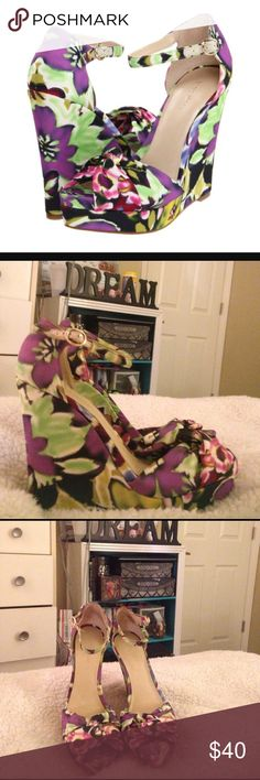 Floral wedges Floral print wedges. Worn once. Only signs of wear are on the inside heel (little dark marks) but are unseen when worn. Super cute for spring and summer! I no longer have the box that came with them. I can take better pictures in natural sunlight at request. Nine West Shoes Wedges