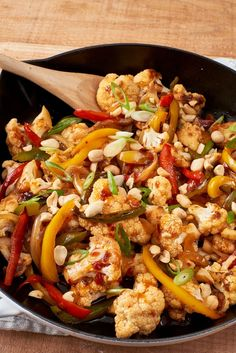Vegetarian Kung Pao Cauliflower Recipe. This healthy take on Chinese takeout is perfect if you're looking for quick and easy weeknight recipes and ideas! This dinner on a budget is tasty and fresh. This stir fry is a tasty way to eat more veggies! You'll need: soy sauce, vinegar, sambal, sesame oil, sugar, cauliflower, bell peppers, onion, ginger, peanuts, green onions, and steamed rice to serve.
