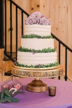 White butter cream cake with greenery and light purple flowers and linen, gold vintage cake stand | Elegant Styled Barn Wedding at Chickadee Hill Farms in Troutman NC - Flashpoint Photography | Love & Lavender Wedding Planning Guide, Honeymoon Planning, Wedding Blog, Wedding Styles, Wedding Reception, Wedding Cake Stands, Wedding Cakes, Light Purple Flowers, Barn Wedding Inspiration