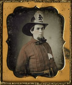 Circa 1850 hand-painted daguerreotype portrait of a fireman.