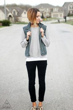 Cute, everyday casual outfit idea featuring leopard sneakers and neutral layers. Denim vest, gray tee, black denim and leopard sneakers.