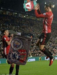 The Manchester United striker slam dunks the crest of bitter rivals Liverpool into a bin