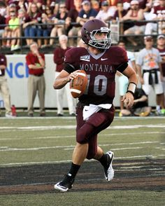 Jordan Johnson, the Quarterback for the University of Montana Grizzlies, looks to throw a pass in the 2013 season opener against App State.