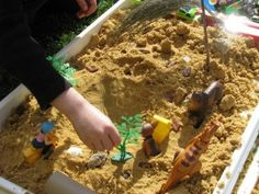 SENSORY PLAY WITH SAND  You will need sand, a box filled with bits and pieces, toy animals, recycled items such as toilet rolls, empty bottles and boxes and also a collection of natural items from the garden such as leaves, twigs and stones.