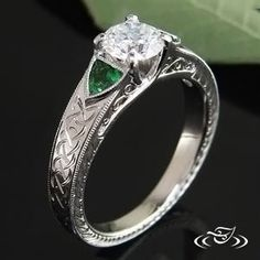 View Detail Page- Platinum Mounting with Diamond, Tsavorite Garnet, Celtic Engraving and Filigree. Side faces of mounting are pierced through at shoulders and have 3-curl filigree panels in each opening. Custom Portfolio Design - Create Your Own Original! Contact us for more Information * Prices do not include center stones unless noted.