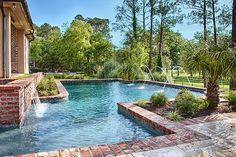 Geometric pool with brick coping and deck jets | Morehead Pools, Shreveport, LA http://www.luxurypools.com/swimmingpoolbuilder/Morehead-Pools-Arkansas?fid=56