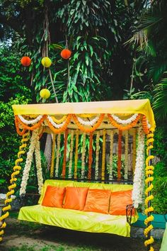Genda flower decor ,mehendi swing , floral decor , colorful yellow and orange…
