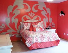Wow! How cool is that! By choosing colors to match her bedding, Debbie really made a statement with this bright pink damask mural pattern from Elephants on the Wall.
