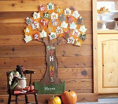 Pottery Barn Kids - Thanksgiving calendar tree (fabric leaves made into small envelopes to tuck notes of thanks into each day)