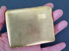 Small Art Deco cigarette case / business card case with fine engine engraved design. Marked Made in France. Made of a golden metal, probably brass: it almost looks like real gold.  3.1 x 2.4 inches (8 x 6,5 cm). In good antique condition, small dents and oxidation spots. One larger spot on a corner (see last picture). Please dont hesitate to contact me if you would like more info or pictures.
