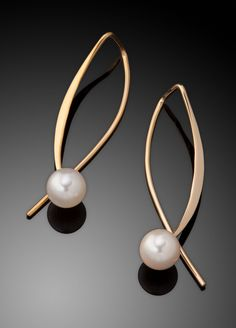 Gold and Pearl Earrings by Ben Dyer. 14K gold earrings with a 6 mm fine cultured pearl. The earring dangles 1 3/8
