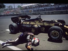 Nigel Mansell passes out from exhaustion after trying to push his Lotus across the finish line