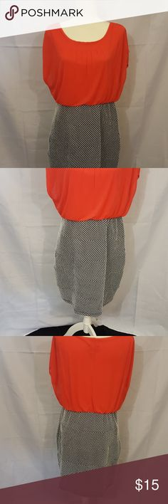 Dress Coral top with black & white bottom. Dress length to you knee.  Dress has never been woren. Enfocus Women Dresses