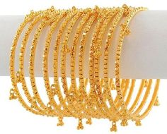 Gold Churis (set of 12 bangles) with diamond cuts and frosty filigree designs. Handing Ghoogri around each bangles gives it a perfect bridal bangle set. Bangles are smooth finished inside for easy slide through. The Bangles, Bridal Bangles, Bridal Jewelry, Bracelets Design, Gold Bangles Design, Gold Jewellery Design, Diamond Jewellery, Silver Jewellery, Jewellery Bracelets