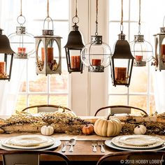 Now that's a bright idea! Hang lanterns filled with autumn-inspired floral and candles for a vibrant fall focal piece! Lanterns Decor, Hanging Lanterns, Fall Home Decor, Autumn Home, Autumn Inspiration, Home Decor Inspiration, Fall Festival Crafts, Farmhouse Chic, Country Farmhouse