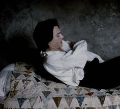 sleepy hollow quilt, I really like how you can see that the quilt isn't bound with binding.  Absolutely lovely antique quilt. Not so bothered by Johnny Depp but would love this quilt on my bed