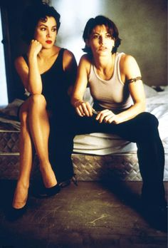 """Jennifer Tilly as Violet (left) and Gina Gershon as Corky (right) in The Wachowski Brothers' pulse-pounding feature film debut """"Bound"""" (1996). Jennifer Tilley, Tiffany Bride Of Chucky, Gina Gershon, Riot Grrrl, The Girlfriends, Love Affair, Movies Showing, Pretty People, Lesbian"""