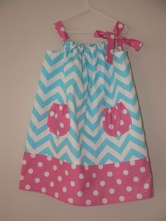 Jen makes the most amazing dresses! Check out her matching doll outfits and headbands, too. Turquoise and Pink Chevron and Polka Dot by MakeItSewbyJen on Etsy, $20.00