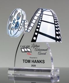 Choose our exclusive Film Reel Trophy to recognize your top achievers! Constructed from premium quality acrylic and custom printed in full color. Your congratulatory message will be printed underneath the movie reel design. Acrylic Plaques, Office Wall Design, Glass Awards, Custom Trophies, Laser Cutter Ideas, Vintage Photo Frames, Acrylic Awards, Trophy Design, Film Reels