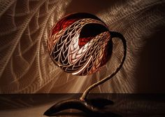 Very cool lamp made from carving a gourd! AMAZING and look at the pattern it casts? Love this!