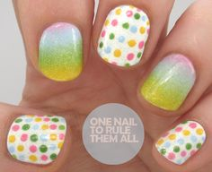 base of Graffiti Nails – Ice White, and then I painted out Nicole by OPI – Hit the Lights (yellow), Deborah Lippmann – Blue Orchid, Barry M – Bright Pink and OPI – Green-wich Village on to a piece of paper, and sponged the colours on to my nail. I also used the same colours and a dotting tool for the polka dots. When dry, I applied a layer of China Glaze – Fairy Dust