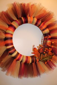 """Fall tulle wreath:  10"""" styrofoam ring and tulle. Cut the tulle 15"""" and then tie it around the ring. hot glue the flowers and such on."""