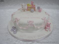 Single tier white and pink christening cake with elephant, teddy and toybox sugar models. Pink swagg ribbons and bows made from icing surround the cake sides http://www.cakescrazy.co.uk/details/pink-teddy-elephant-toybox-christening-cake-8763.html