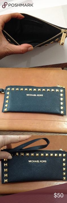 Black Michael Kors wristlet Thin wristlet , mint condition evening clutch or day pouch.  Black inside and out.  Inside has 3 credit card holders on one side. Michael Kors Bags Clutches & Wristlets