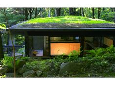 Dragon Rock: Restored Studio with Green Roof. Russel Wright's studio, restored to its 1962 appearance, photographed at dusk. Photo by Tara Wing; Courtesy of Manitoga/The Russel Wright Design Center