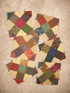 It's really funny to stumble across these on Pinterest. They are orphan blocks I bought long ago on my guild's garage sale! The little untrimmed dog-ears make them look like Japanese houses, don't you think?!