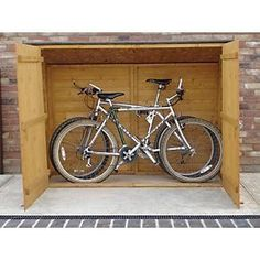 Bike storage Shed - Solid Wood Bike Storage with Maximum Security System from Shire . Bicycle Storage Shed, Outdoor Bike Storage, Bike Shed, Shed Storage, Garage Velo, Bike Locker, Bike Storage Solutions, Storage Ideas, Bike Shelter