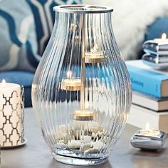 A stunning dance of candlelight! Includes a silver-tone metal tealight hanger for three tealights, sold separately. Candles And Candleholders, Candle Jars, Candle Holders, Hurricane Lanterns, Hurricane Glass, Candles Online, Candle Accessories, Best Candles, Tea Lights